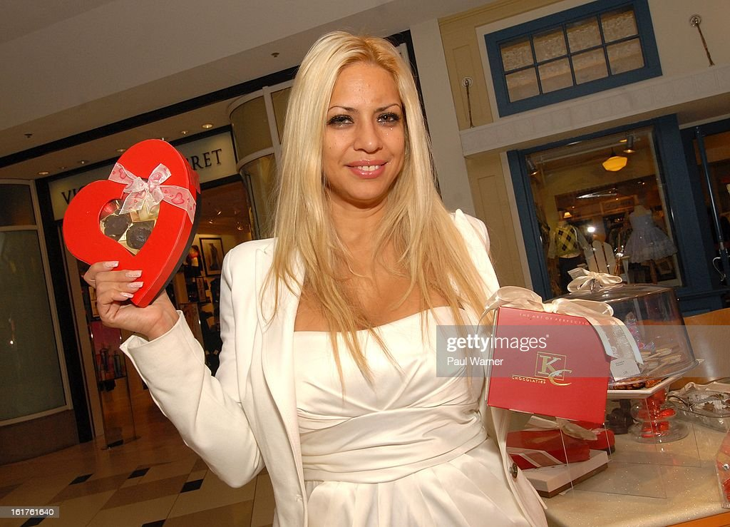 Actress <a gi-track='captionPersonalityLinkClicked' href=/galleries/search?phrase=Dita+de+Leon&family=editorial&specificpeople=635438 ng-click='$event.stopPropagation()'>Dita de Leon</a> poses at the Twelve Oaks Mall while promoting the Haagen-Dazs/KC Chocolatier store on February 14, 2013 in Novi, Michigan.