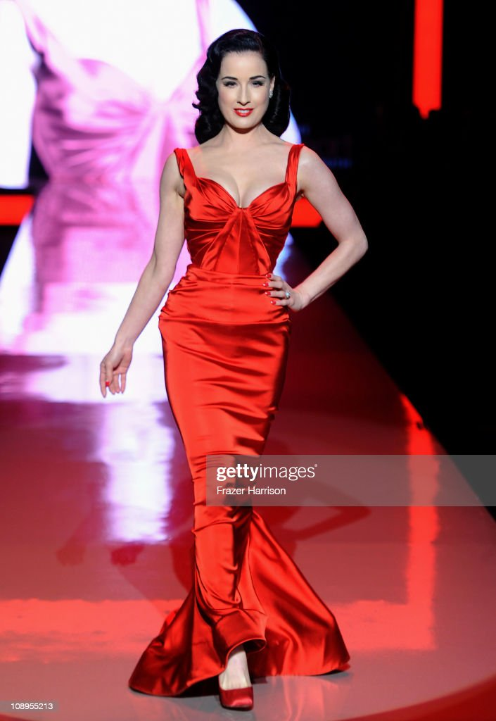Actress Dita Von Teese walks the runway at the Heart Truth Fall 2011 fashion show during Mercedes-Benz Fashion Week at The Theatre at Lincoln Center on February 9, 2011 in New York City.