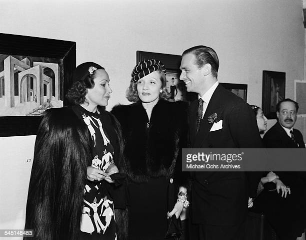 Actress Dolores del Rio and Marlene Dietrich and Douglas Fairbanks Jr attend a gallery event featuring Mexican artist Frida Kahlo in Los Angeles...