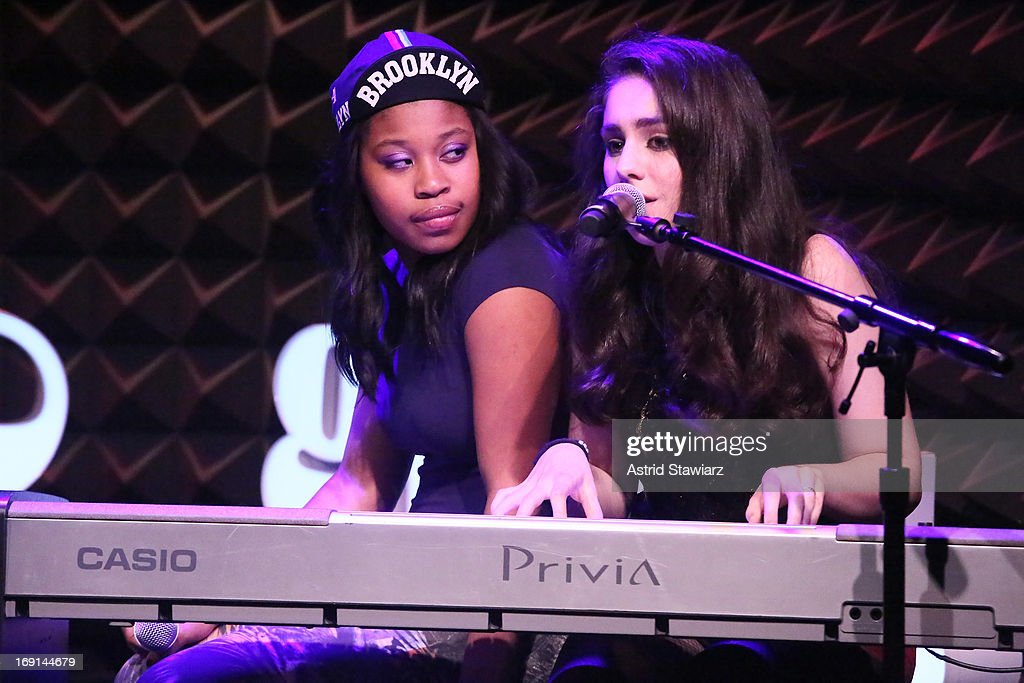 Actress Dominique Fishback (L) and Musician Samia Finnerty perform at Glamour's presentation of 'These Girls' at Joe's Pub on May 20, 2013 in New York City.