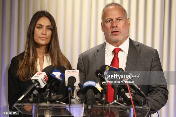 Actress Dominique Huett and her attorney Jeff Herman speak during a press conference regarding Huett's lawsuit against The Weinstein Company at the...