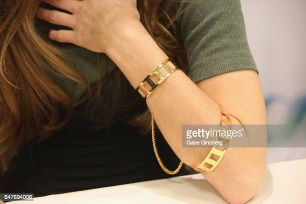 Actress Dominique ProvostChalkley braclet detail attends ClexaCon 2017 convention at Bally's Las Vegas on March 3 2017 in Las Vegas Nevada