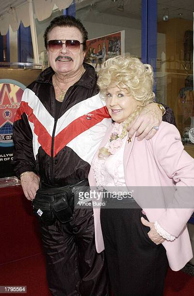 Actress Donna Douglas and actor Max Baer Jr pose at the ceremony honoring legendary banjo player Earl Scruggs with a star on the Hollywood Walk of...