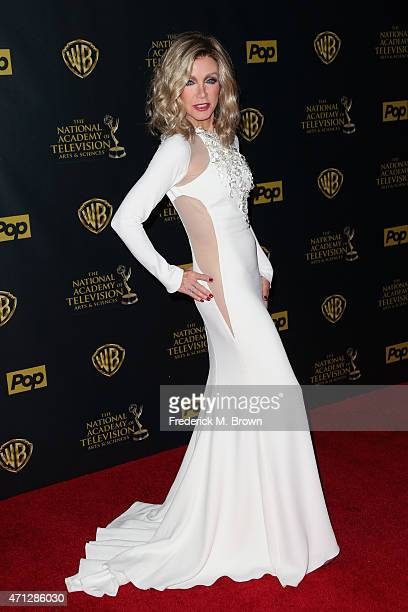 Actress Donna Mills poses in the press room during The 42nd Annual Daytime Emmy Awards at Warner Bros Studios on April 26 2015 in Burbank California