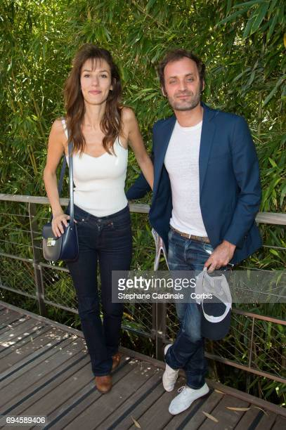 Actress Doria Tillier and journalist Augustin Trapenard attend the French Tennis Open Day Fourteen at Roland Garros on June 10 2017 in Paris France
