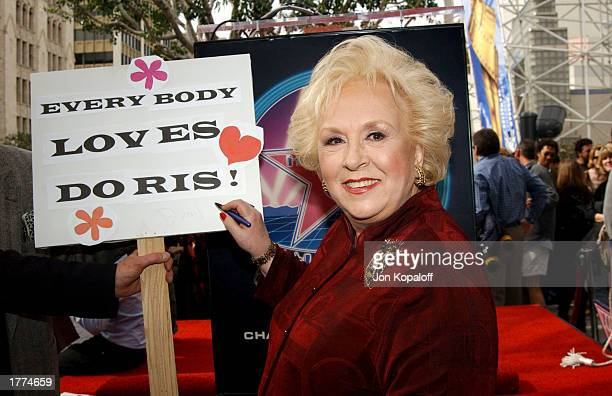 Actress Doris Roberts autographs a sign that reads 'Everybody Loves Doris' during the ceremony honoring her on the Hollywood Walk of Fame on February...