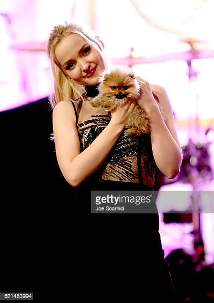 Actress Dove Cameron and puppy onstage during the 23rd Annual Race To Erase MS Gala at The Beverly Hilton Hotel on April 15 2016 in Beverly Hills...