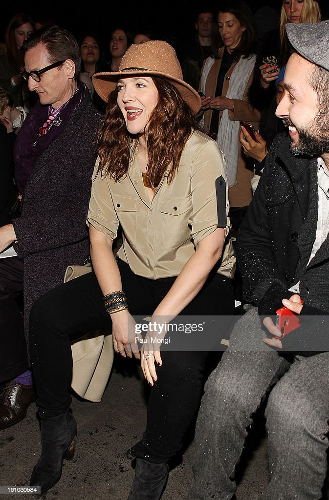 Actress <a gi-track='captionPersonalityLinkClicked' href=/galleries/search?phrase=Drew+Barrymore&family=editorial&specificpeople=201623 ng-click='$event.stopPropagation()'>Drew Barrymore</a> along the front row at Rag & Bone Women's Collection during Fall 2013 Mercedes-Benz Fashion Week at Skylight Studios at Moynihan Station on February 8, 2013 in New York City.