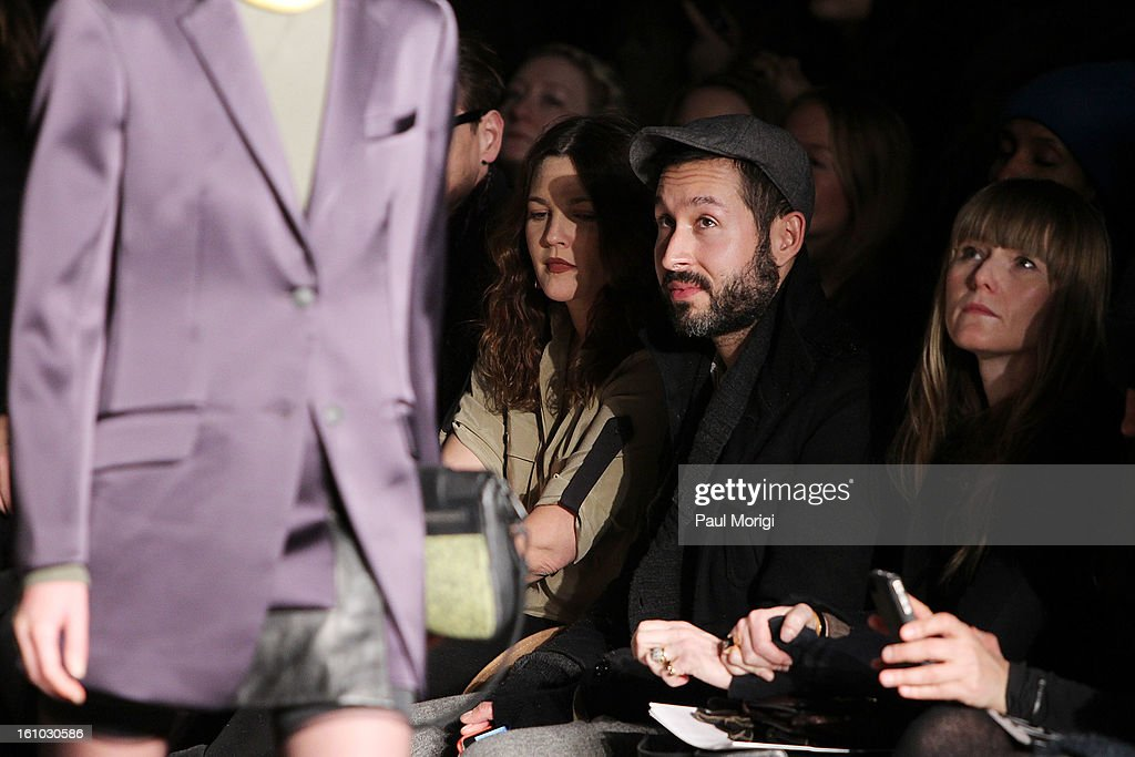 Actress <a gi-track='captionPersonalityLinkClicked' href=/galleries/search?phrase=Drew+Barrymore&family=editorial&specificpeople=201623 ng-click='$event.stopPropagation()'>Drew Barrymore</a> (L) and a guest watch a model on the runway at Rag & Bone Women's Collection during Fall 2013 Mercedes-Benz Fashion Week at Skylight Studios at Moynihan Station on February 8, 2013 in New York City.