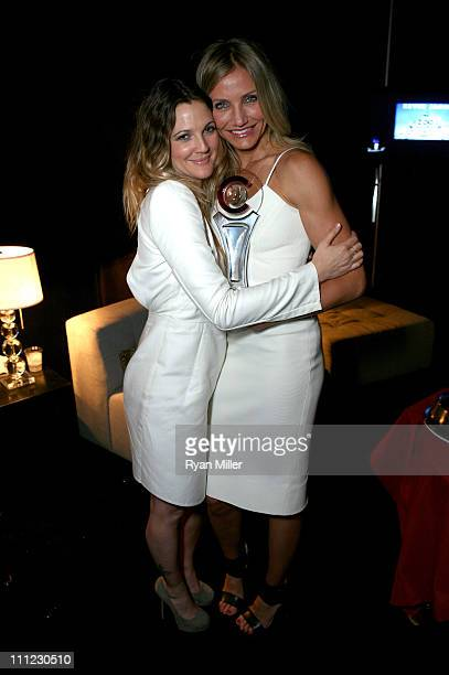 Actress Drew Barrymore and actress Cameron Diaz with her Female Star of the Year award during CinemaCon the official convention of the National...