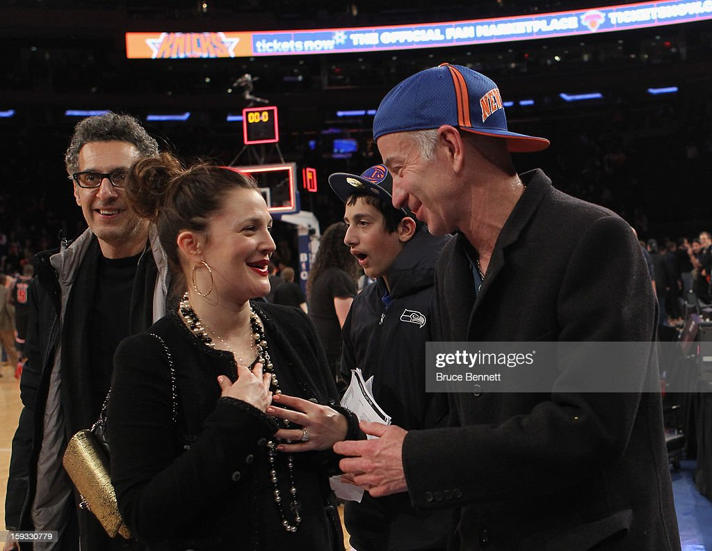 Actress Drew Barrymore and former tennis player John McEnroe chat following the New York Knicks 108-101 loss to the Chicago Bulls at Madison Square Garden on January 11, 2013 in New York City.