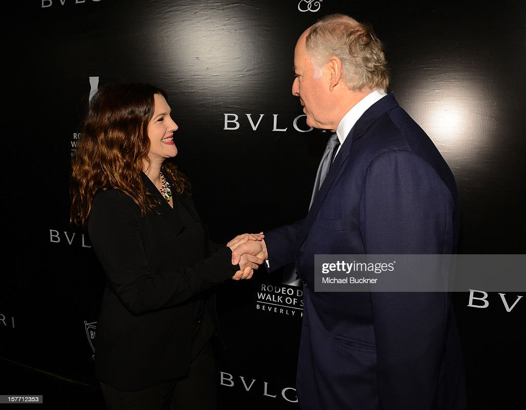 Actress Drew Barrymore and honoree Nicola Bulgari attend the Rodeo Drive Walk Of Style honoring BVLGARI and Mr. Nicola Bulgari held at Bulgari on December 5, 2012 in Beverly Hills, California.