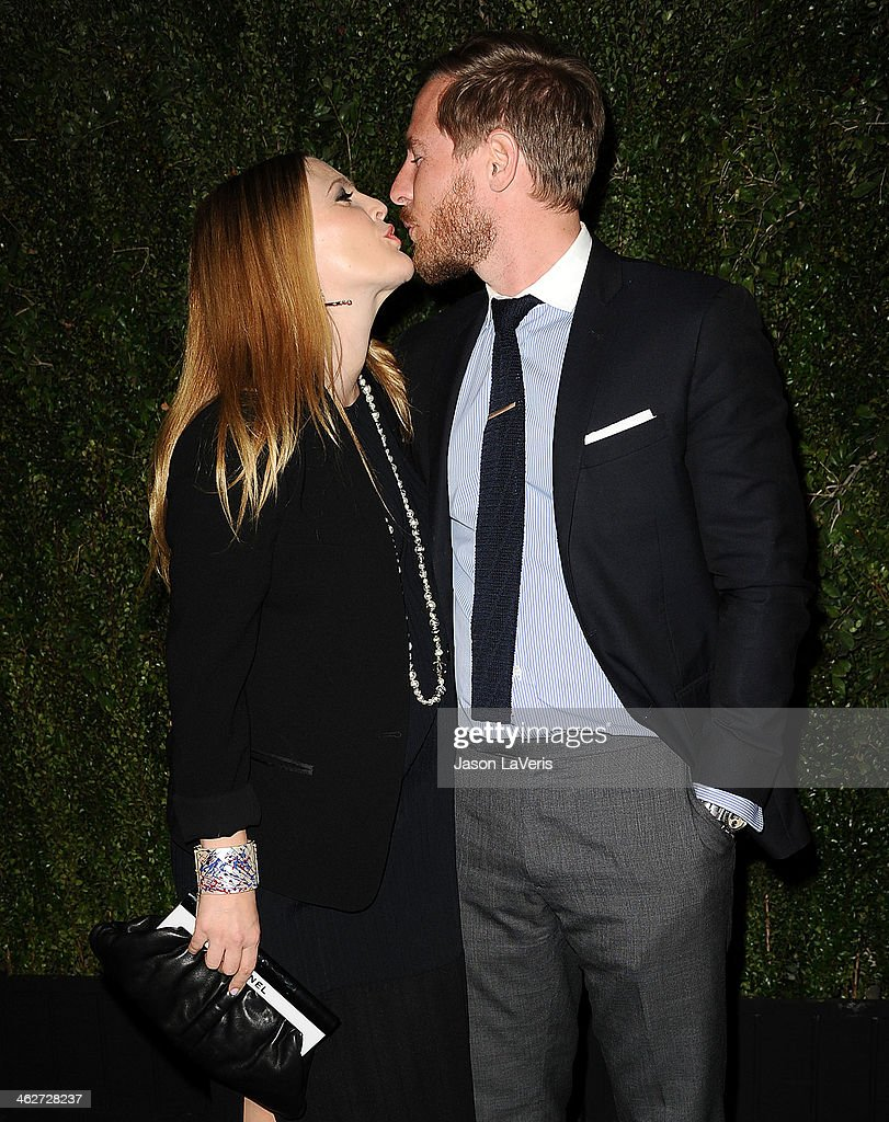 Actress Drew Barrymore and husband Will Kopelman attend the release of 'Find It In Everything' at Chanel Boutique on January 14, 2014 in Beverly Hills, California.