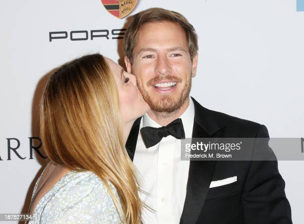 Actress Drew Barrymore and Will Kopelman attend the Second Annual Baby2Baby Gala at the Book Bindery on November 9 2013 in Culver City California