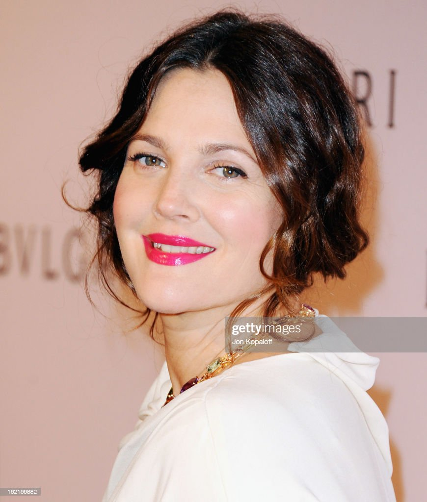 Actress <a gi-track='captionPersonalityLinkClicked' href=/galleries/search?phrase=Drew+Barrymore&family=editorial&specificpeople=201623 ng-click='$event.stopPropagation()'>Drew Barrymore</a> arrives at the Elizabeth Taylor Bulgari Event At The New Bulgari Beverly Hills Boutique on February 19, 2013 in Beverly Hills, California.