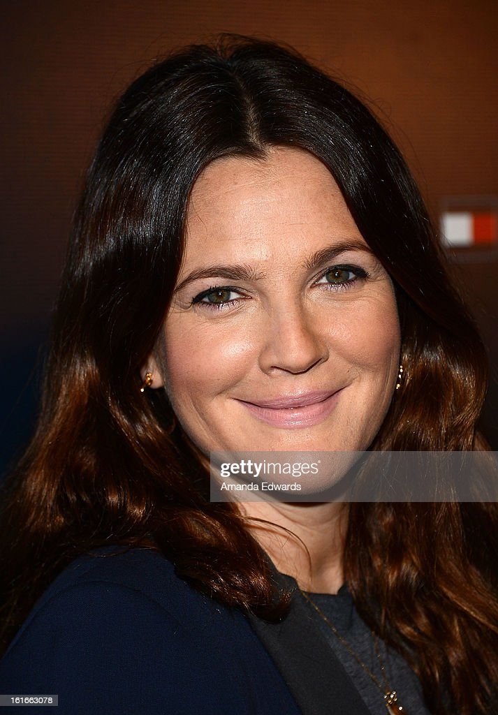 Actress <a gi-track='captionPersonalityLinkClicked' href=/galleries/search?phrase=Drew+Barrymore&family=editorial&specificpeople=201623 ng-click='$event.stopPropagation()'>Drew Barrymore</a> arrives at the Tommy Hilfiger West Coast Flagship Grand Opening Event at Tommy Hilfiger West Hollywood on February 13, 2013 in West Hollywood, California.