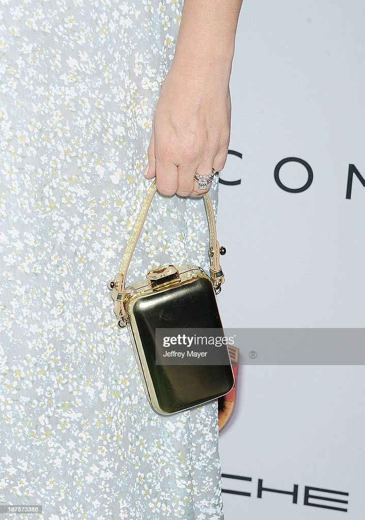 Actress Drew Barrymore (handbag, ring detail) at the 2nd Annual Baby2Baby Gala at The Book Bindery on November 9, 2013 in Culver City, California.