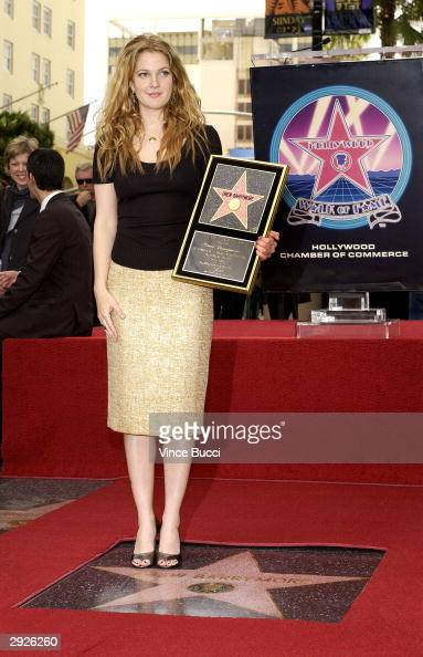Actress Drew Barrymore attends the ceremony honoring her with a star on the Hollywood Walk of Fame February 3 2004 in Hollywood California
