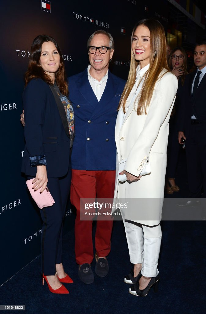 Actress <a gi-track='captionPersonalityLinkClicked' href=/galleries/search?phrase=Drew+Barrymore&family=editorial&specificpeople=201623 ng-click='$event.stopPropagation()'>Drew Barrymore</a>, designer Tommy Hilfiger and actress <a gi-track='captionPersonalityLinkClicked' href=/galleries/search?phrase=Jessica+Alba&family=editorial&specificpeople=201811 ng-click='$event.stopPropagation()'>Jessica Alba</a> arrive at the Tommy Hilfiger West Coast Flagship Grand Opening Event at Tommy Hilfiger West Hollywood on February 13, 2013 in West Hollywood, California.