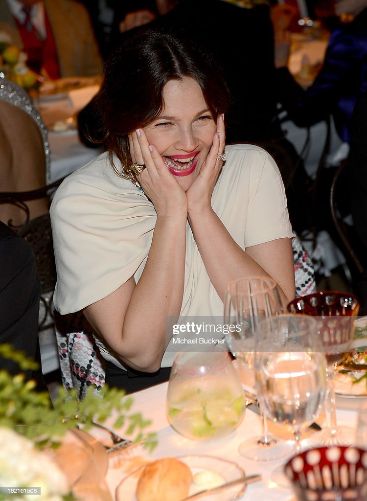 Actress <a gi-track='captionPersonalityLinkClicked' href=/galleries/search?phrase=Drew+Barrymore&family=editorial&specificpeople=201623 ng-click='$event.stopPropagation()'>Drew Barrymore</a> in BVLGARI attends the BVLGARI celebration of Elizabeth Taylor's collection of BVLGARI jewelry at BVLGARI Beverly Hills on February 19, 2013 in Los Angeles, California.