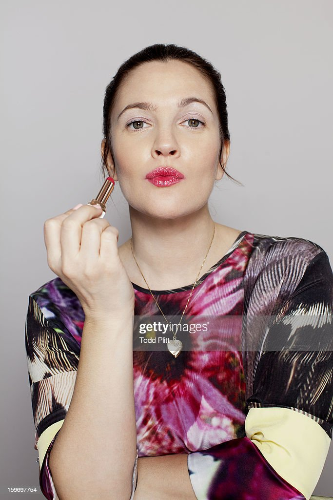 Actress <a gi-track='captionPersonalityLinkClicked' href=/galleries/search?phrase=Drew+Barrymore&family=editorial&specificpeople=201623 ng-click='$event.stopPropagation()'>Drew Barrymore</a> is photographed with her new cosmetic line 'Flower' for USA Today on January 14, 2013 in New York City.