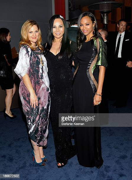 Actress Drew Barrymore LACMA Trustee and CoChair Eva Chow and actress Zoe Saldana wearing Gucci attend the LACMA 2013 Art Film Gala honoring Martin...