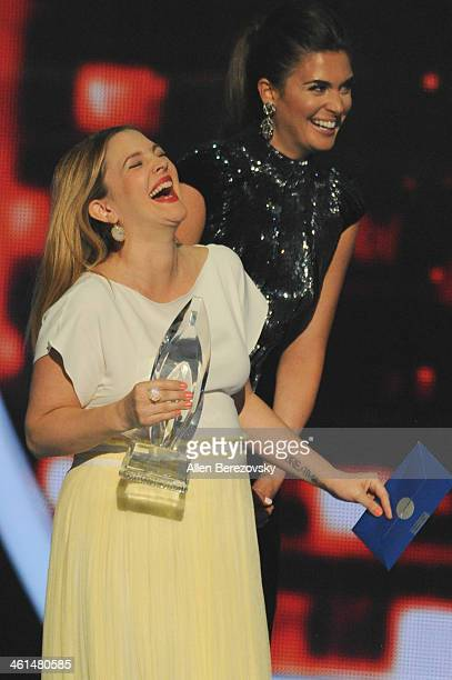Actress Drew Barrymore laughs onstage at The 40th Annual People's Choice Awards show at Nokia Theatre LA Live on January 8 2014 in Los Angeles...