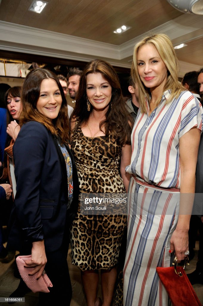 Actress Drew Barrymore (L), tv personality Lisa Vanderpump and Dee Hilfiger (R) attend Tommy Hilfiger New West Coast Flagship Opening on Robertson Boulevard on February 13, 2013 in West Hollywood, California.