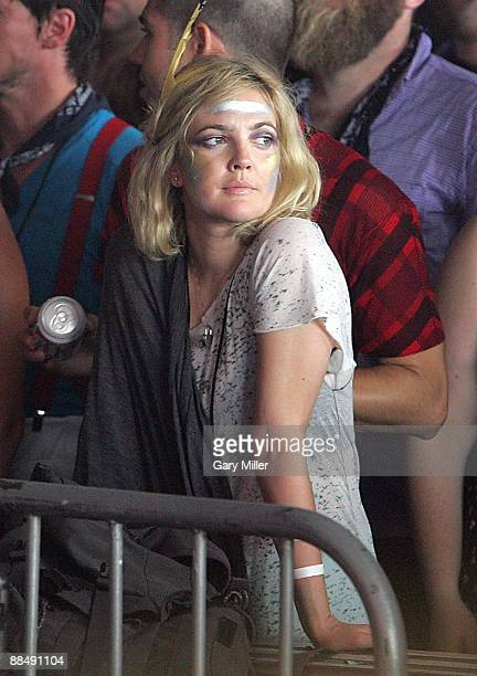 Actress Drew Barrymore watches Bon Iver perform during the 2009 Bonnaroo Music and Arts Festival on June 13 2009 in Manchester Tennessee