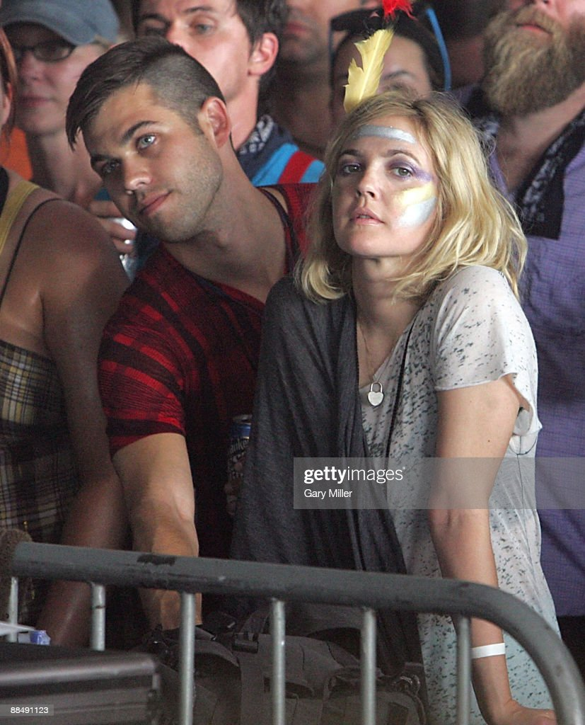 Actress <a gi-track='captionPersonalityLinkClicked' href=/galleries/search?phrase=Drew+Barrymore&family=editorial&specificpeople=201623 ng-click='$event.stopPropagation()'>Drew Barrymore</a> watches Bon Iver perform during the 2009 Bonnaroo Music and Arts Festival on June 13, 2009 in Manchester, Tennessee.
