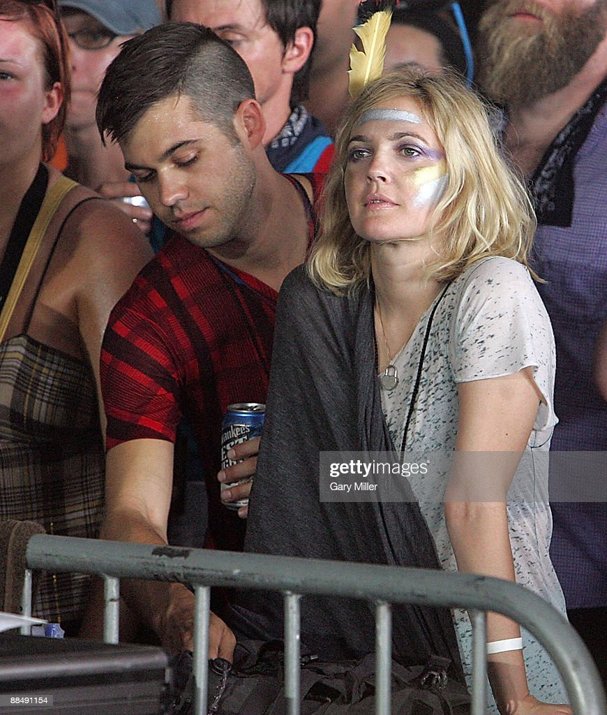 Actress Drew Barrymore watches Bon Iver perform during the 2009 Bonnaroo Music and Arts Festival on June 13, 2009 in Manchester, Tennessee.