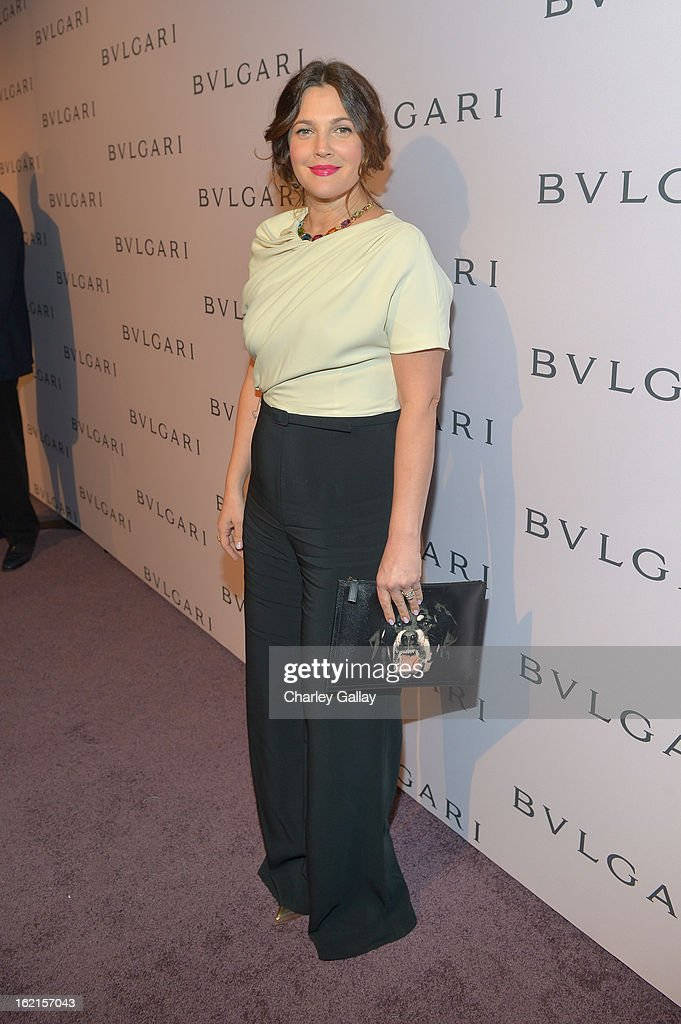 Actress <a gi-track='captionPersonalityLinkClicked' href=/galleries/search?phrase=Drew+Barrymore&family=editorial&specificpeople=201623 ng-click='$event.stopPropagation()'>Drew Barrymore</a>, wearing BVLGARI, arrives at the BVLGARI celebration of Elizabeth Taylor's collection of BVLGARI jewelry at BVLGARI Beverly Hills on February 19, 2013 in Los Angeles, California.