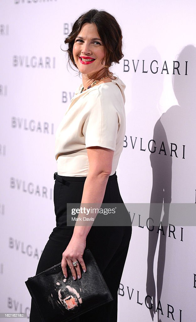 Actress Drew Barrymore, wearing BVLGARI, arrives at the BVLGARI celebration of Elizabeth Taylor's collection of BVLGARI jewelry at BVLGARI Beverly Hills on February 19, 2013 in Los Angeles, California.