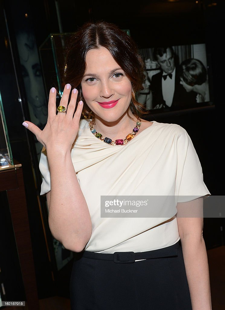 Actress Drew Barrymore, wearing BVLGARI, attends the BVLGARI celebration of Elizabeth Taylor's collection of BVLGARI jewelry at BVLGARI Beverly Hills on February 19, 2013 in Los Angeles, California.