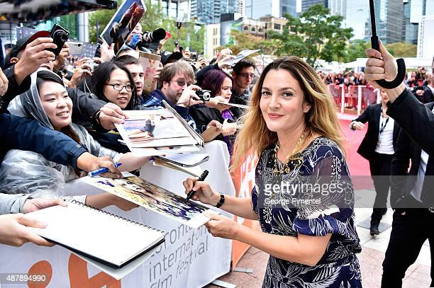 Actress Drew Barrymore with fans attends the 'Miss You Already' premiere during the 2015 Toronto International Film Festival at Roy Thomson Hall on...