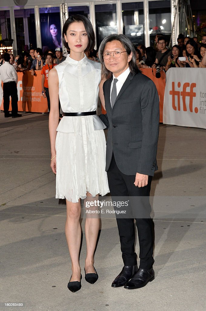 Actress <a gi-track='captionPersonalityLinkClicked' href=/galleries/search?phrase=Du+Juan&family=editorial&specificpeople=3972788 ng-click='$event.stopPropagation()'>Du Juan</a> and director/producer Peter Ho-sun Chan arrive at the 'American Dreams' Premiere during the 2013 Toronto International Film Festival at Roy Thomson Hall on September 10, 2013 in Toronto, Canada.