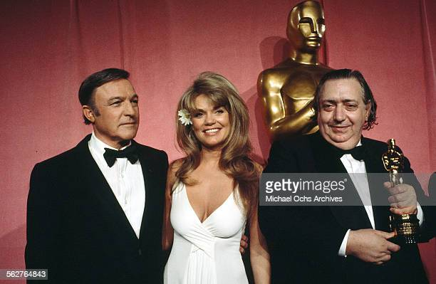 Actress Dyan Cannon with actor Gene Kelly pose backstage after presenting 'Academy Honorary Award' award to archivist Henri Langlois during the 46th...