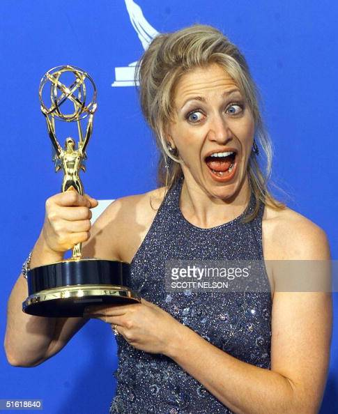 Actress Edie Falco holds her Emmy Award for Outstanding Actress in a Drama Series for her role in 'The Sopranos' at the Shrine Auditorium in Los...