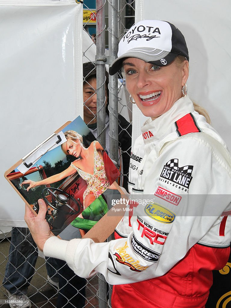 Actress <a gi-track='captionPersonalityLinkClicked' href=/galleries/search?phrase=Eileen+Davidson&family=editorial&specificpeople=663986 ng-click='$event.stopPropagation()'>Eileen Davidson</a> signs a picture of herself during the 36th Annual Toyota Pro/Celebrity Race - Press Practice Day of the Toyota Grand Prix of Long Beach on April 13, 2012 in Long Beach, California.