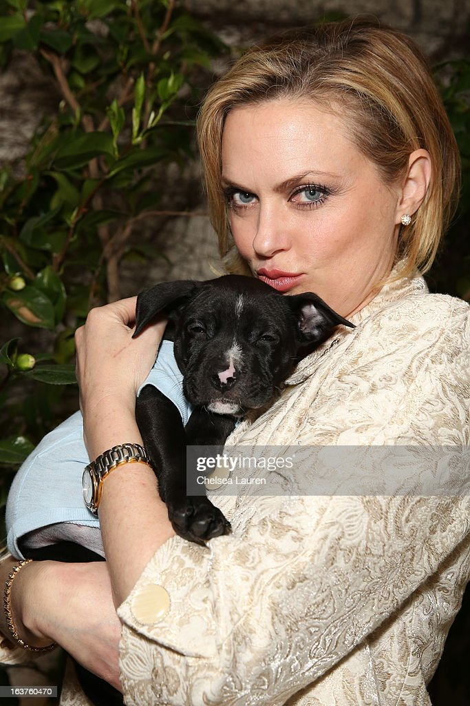 Actress Elaine Hendrix poses with a dog wearing Lyric Culture for PetSmart at Much Love Animal Rescue's makeovers for mutts at Peninsula Hotel on March 14, 2013 in Beverly Hills, California.