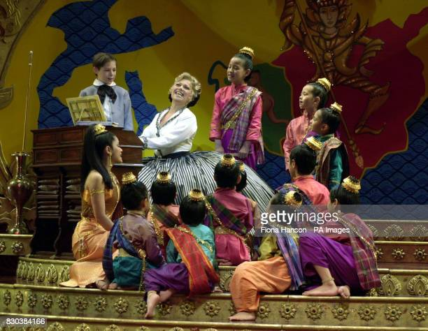 Actress Elaine Paige plays the piano to listening children during rehearsals for the stage musical of 'The King And I' currently previewing at the...