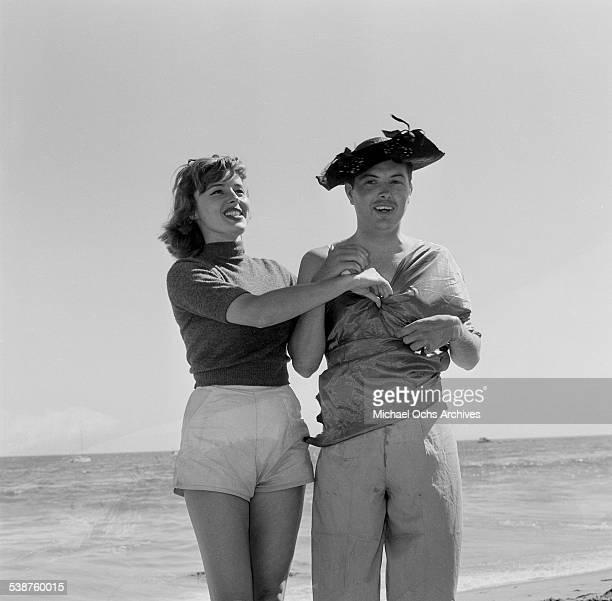 Actress Elaine Stewart dresses man during the Thalians Beach Ball in MalibuCalifornia