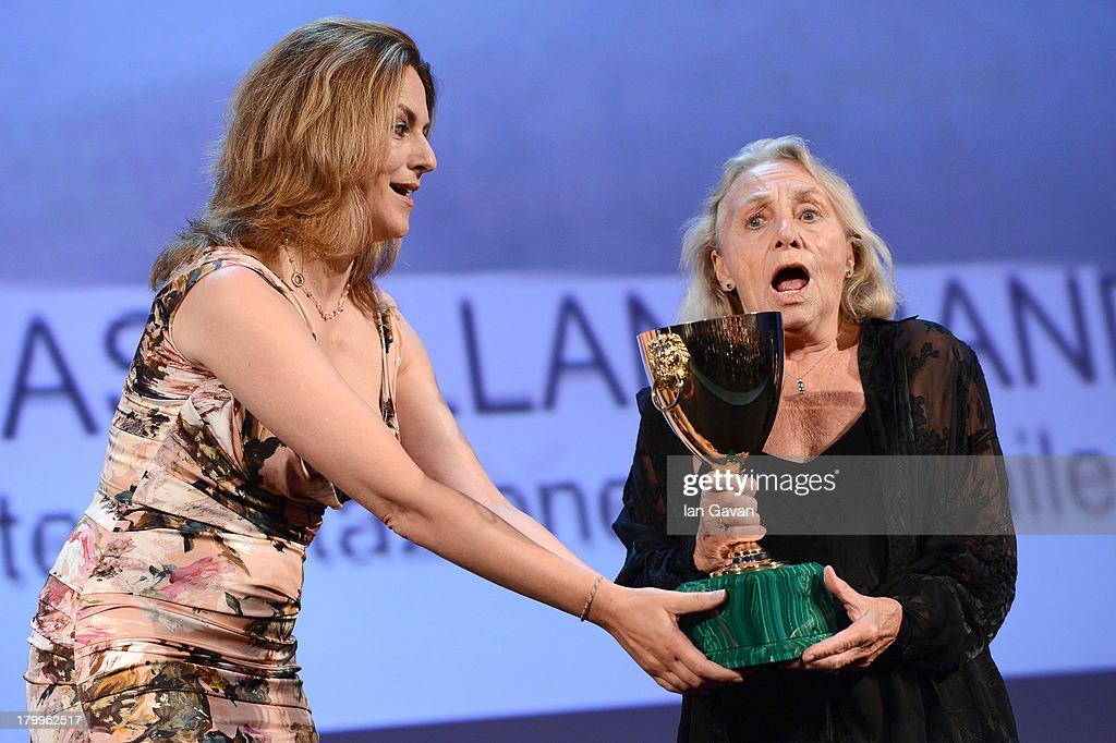 Actress Elena Cotta (R) accepts Coppa Volpi for Best Actress for 'Via Castellana Bandiera' from Jury member Martina Gedeck on stage during the Closing Ceremony at the 70th Venice International Film Festival at the Palazzo del Casino on September 7, 2013 in Venice, Italy.