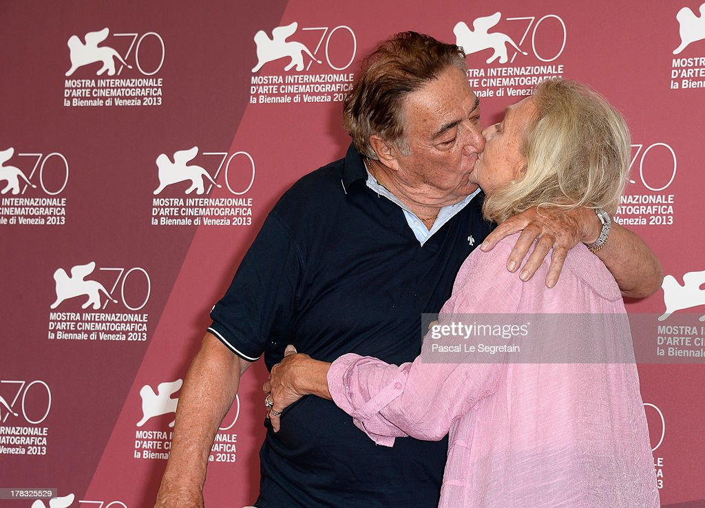Actress Elena Cotta and her husband, actor Carlo Alighiero, share a kiss as they attend the 'Via Castellana Bandiera' Photocall during the 70th Venice International Film Festival on August 29, 2013 in Venice, Italy