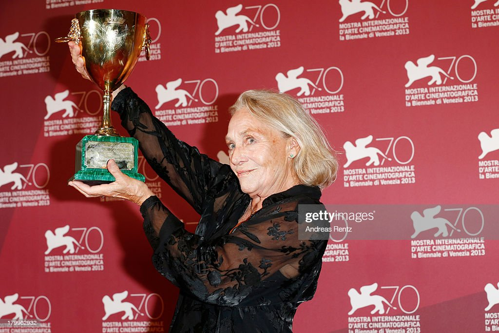 Actress <a gi-track='captionPersonalityLinkClicked' href=/galleries/search?phrase=Elena+Cotta&family=editorial&specificpeople=11308432 ng-click='$event.stopPropagation()'>Elena Cotta</a> poses with the Best Actress Award she received for her role in the movie 'Via Castellana Bandiera' as she attends the Award Winners Photocall during the 70th Venice International Film Festival at Palazzo del Casino on September 7, 2013 in Venice, Italy.