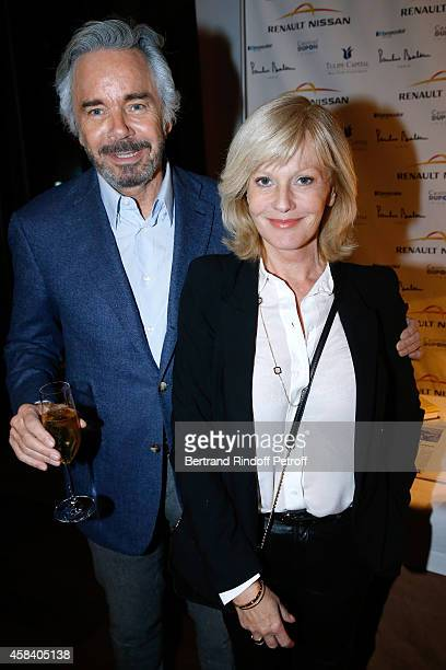 Actress Elisa Servier and her companion Pascal Cromback attend JeanDaniel Lorieux signs his Book 'Sunstroke' at the Art Bookshop of the 'Royal...