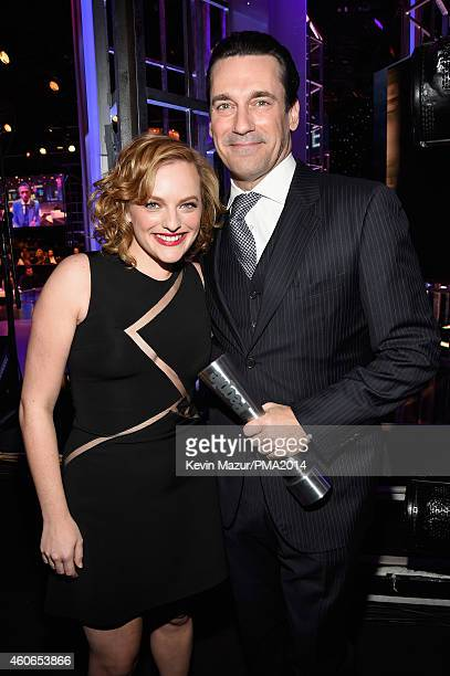 Actress Elisabeth Moss and actor Jon Hamm winner of the TV Actor of the Year award attend the PEOPLE Magazine Awards at The Beverly Hilton Hotel on...