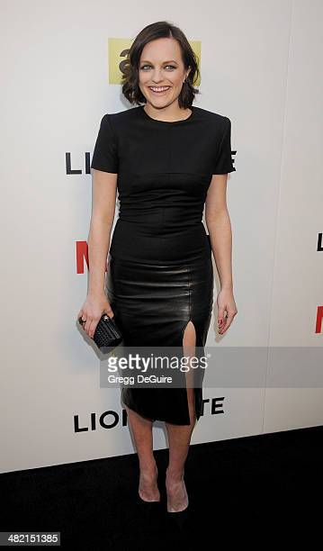 Actress Elisabeth Moss arrives at AMC's 'Mad Men' Season 7 premiere at ArcLight Cinemas on April 2 2014 in Hollywood California