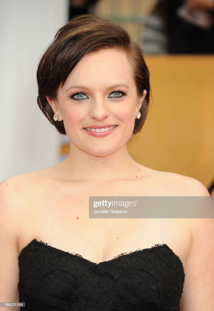 Actress Elisabeth Moss arrives at the 19th Annual Screen Actors Guild Awards held at The Shrine Auditorium on January 27, 2013 in Los Angeles, California.