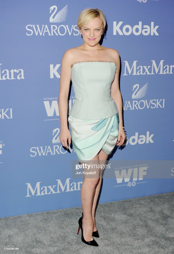Actress <a gi-track='captionPersonalityLinkClicked' href=/galleries/search?phrase=Elisabeth+Moss&family=editorial&specificpeople=3079265 ng-click='$event.stopPropagation()'>Elisabeth Moss</a> arrives at the 2013 Women In Film's Crystal + Lucy Awards at The Beverly Hilton Hotel on June 12, 2013 in Beverly Hills, California.